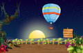 A hot air balloon in a bright full moon illustration of Stock Photography