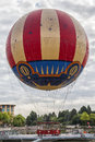 Hot air balloon classic style landed with a coudy sky as background Stock Photos