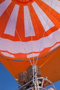 Hot air balloon closeup of a colorful orange and white in flight Stock Photography