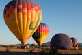 Hot air balloon festival balloons filling up in the early morning desert Royalty Free Stock Images