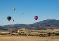 Hot air balloon festival colorful s fly through a mountain valley at the montague fair in northern california Stock Photography