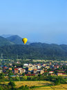 Hot air balloon flying above Vang Vieng town, Vientiane Province Royalty Free Stock Photo