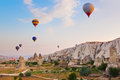 Hot air balloon flying over cappadocia turkey rock landscape at Stock Photos