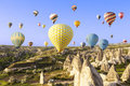 Hot air balloon flying over rock landscape at Cappadocia Royalty Free Stock Photo