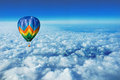Hot air balloon flying on the top of the clouds Royalty Free Stock Images