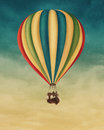 Hot air balloon high in the sky Stock Photography