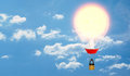 A hot air balloon with an incandescent bulb in place of its envelope on cloudy sky background. Royalty Free Stock Photo