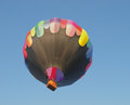 Hot air balloon just launched upward facing underneath view of a after launch against a blue sky with room for copy or text Royalty Free Stock Image