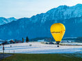 Hot air balloon landing advertising uetendorf area switzerland Stock Photos