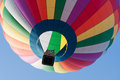 Hot air balloon looking up at a rainbow colored Stock Image