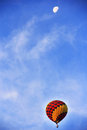 Hot air balloon and the moon Stock Image