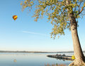 Hot air balloon over lake Stock Photos