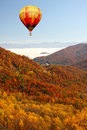 Hot air balloon over mountains in fall colors Stock Photos