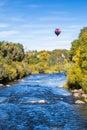 Hot air balloon over river in Colorado Royalty Free Stock Photo