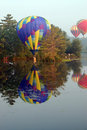 Hot air balloon skimming Stock Images