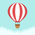 Hot air balloon in the sky with clouds. Flat cartoon design