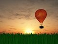 Hot air balloon sunset and grass Stock Photo