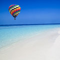 Hot air balloon travel over the sea colorful fly blue Stock Photo