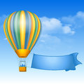 Hot air balloon vintage and message on banner soaring in the sky with clouds Royalty Free Stock Photos
