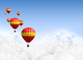 Hot air balloons above the clouds a collection of red and yellow balloon floating on a clear blue sky background Stock Images