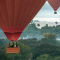 Hot air balloons bagan myanmar burma tourists flying in in the early morning near the irrawaddy river at began in Royalty Free Stock Photo