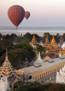 Hot air balloons bagan myanmar slowly drifting by temples near the shwezigon pagoda in the early morning sunlight in burma Royalty Free Stock Images