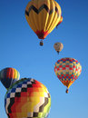 Hot air balloons colorful in flight at the albuquerque new mexico annual balloon fiesta six in varying stages of height Stock Photography