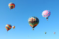 Hot air balloons floating in the blue sky Stock Photo