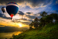 Hot air balloons floating over lake Stock Image