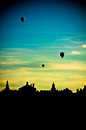 Hot air balloons flying over stockholm three before the sunset Stock Photography