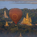 Hot air balloons flying over temples archaeological zone bagan early morning sunlight distance irrawaddy river myanmar burma Royalty Free Stock Photography