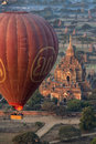 Hot air balloons flying over temples archaeological zone bagan early morning sunlight temple foreground sulamani temple myanmar Royalty Free Stock Images