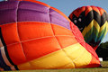 Hot air balloons getting inflated for flight inflating Royalty Free Stock Photography
