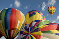 Hot air balloons inflating with another balloon already aloft colorful at the readington festival Royalty Free Stock Photo