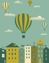 Hot air balloons over the town Stock Photos