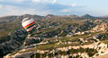 Hot air baloon in cappadocia balloons rise over valley turkey Stock Images