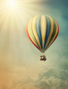 Hot air baloon high in the sky Stock Photo