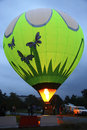 Hot air baloon starting to fly in the evening sky Royalty Free Stock Photo