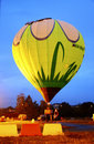 Hot air baloon starting to fly in the evening sky a Stock Photos