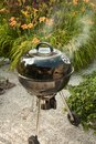 Hot BBQ Grill In A Backyard. Royalty Free Stock Photo