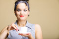 Hot beverage woman holding tea or coffee cup funny girl a of copyspace brown background Royalty Free Stock Image