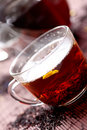 Hot black tea in glass cup Stock Photos