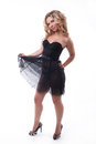 Hot blonde model in a black transparent dress Royalty Free Stock Photos
