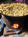 Hot burner with burning red  flame with dry roasted groundnuts Royalty Free Stock Photo