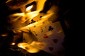 Hot cards bursting into flame Royalty Free Stock Images