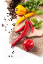 Hot chili peppers with basil red and yellow salt and fresh over white Stock Photo