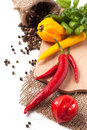Hot chili peppers with basil red and yellow salt and fresh over white Stock Image