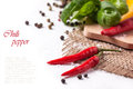 Hot chili peppers with basil red and yellow salt and fresh over white sample text Royalty Free Stock Images