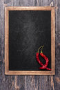 Hot chili peppers on black chalkboard. Menu board Stock Photos
