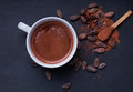 Hot chocolate in a cup on the black background Royalty Free Stock Photo